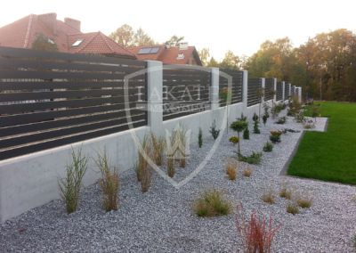 Architectural concrete and aluminum fence
